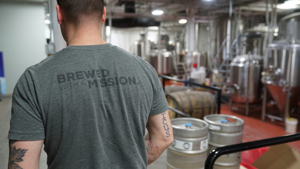 Brewed with a Mission logo on t-shirt