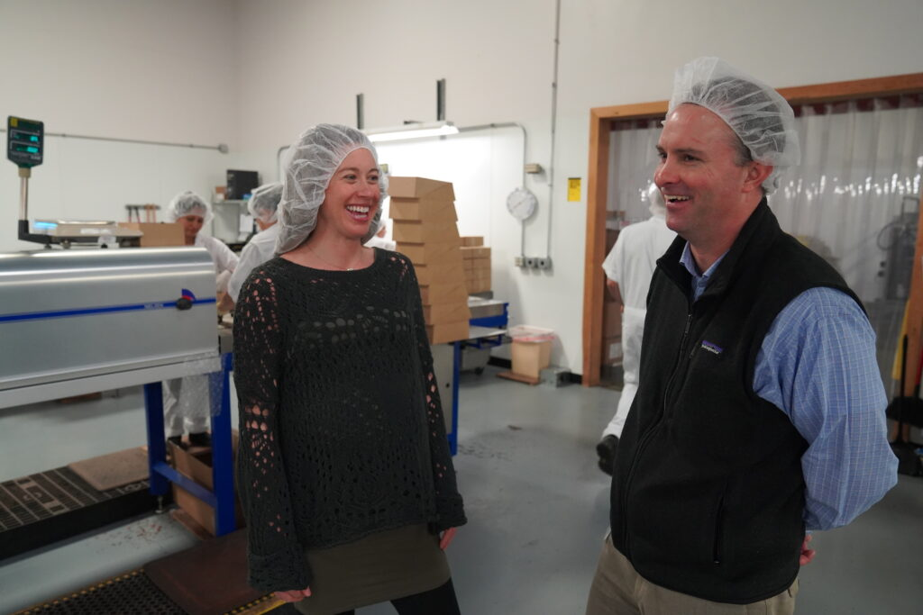 Julia Birnn Fields speaking with Attorney General T.J. Donovan at Birnn Chocolates of Vermont