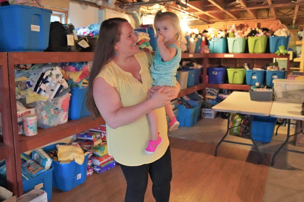 Elizabeth Grimes holding her daughter