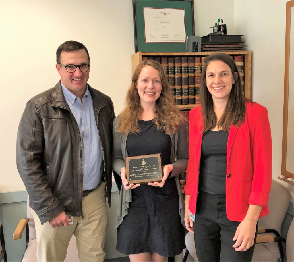 "Rob McDougall, Chief of the Environmental Division, presents Lawyers Fighting Hunger ""friendly competition"" award to representatives of Downs Rachlin Martin PLLC, winner of the large firm division."