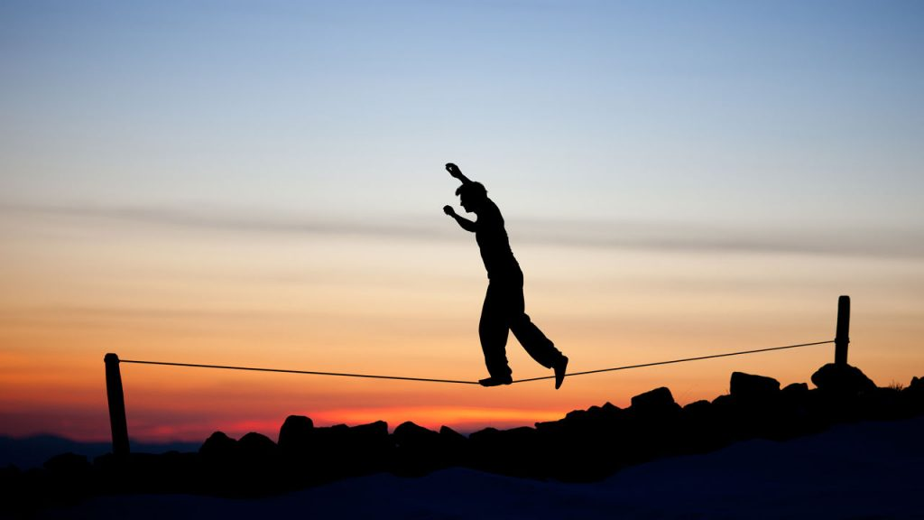 Person Balancing on Wire
