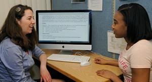 Sierra Kloutz, Class of 2015, tutors a student.