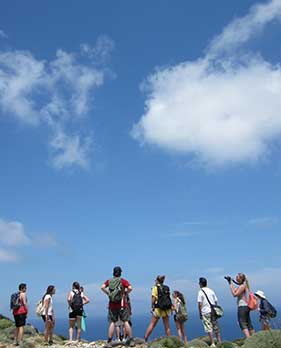 students standing at top of mountain