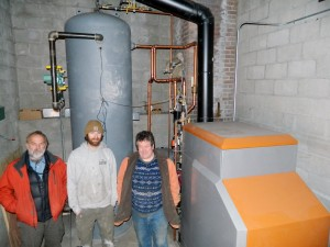 Rob Steingress (VFFC), Bill Kretzer (12 Gauge Electric) and Greg Cox (VFFC) perform final inspections before the initial firing of the boiler.