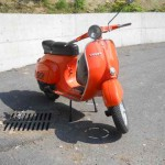 cool orange vespa