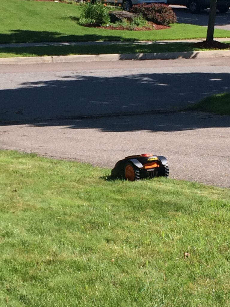 Mower with two wheels on the driveway