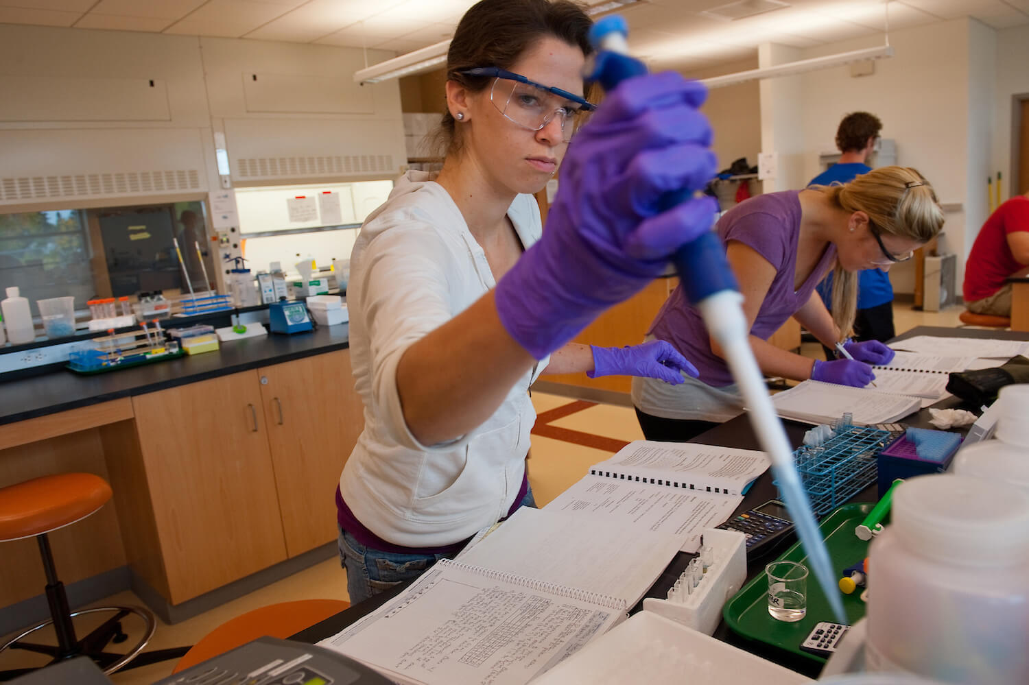 Student in the biochemistry lab, Jeffords Hall