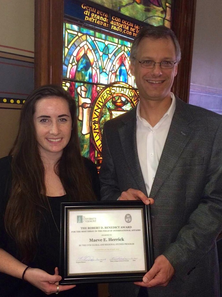 Maeve receiving the Robert B. Benedict Award from Prof. Peter vonDoepp. Global & Regional Studies Interim Director