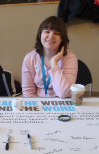 "Picture of Taylor Terry working the ""Spread the Word to End the Word"" campaign table"
