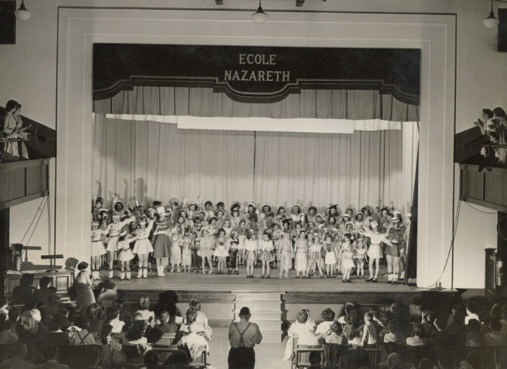 Audience in school auditorium applauds at the May 1952 recital.