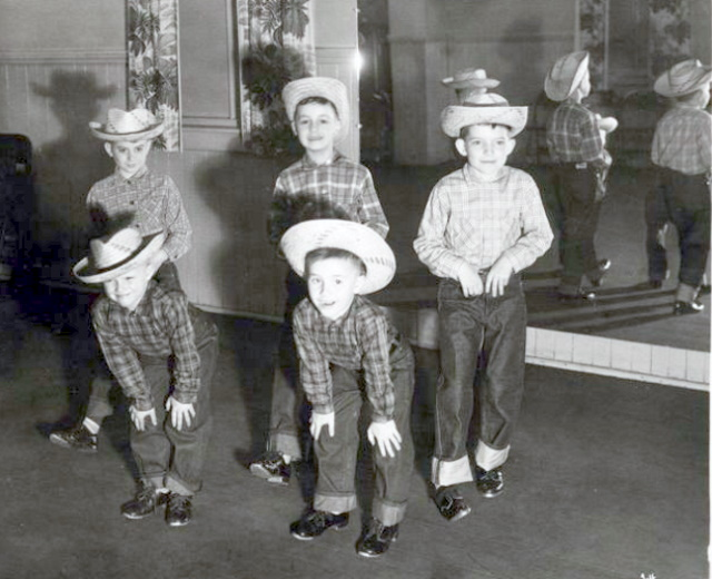 Five young tap dancers in cowboy hats, flannel shirts, and jeans