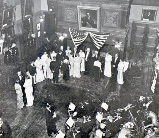 1936 reception in Billings Library with receiving line in front of the fireplace and an orchestra