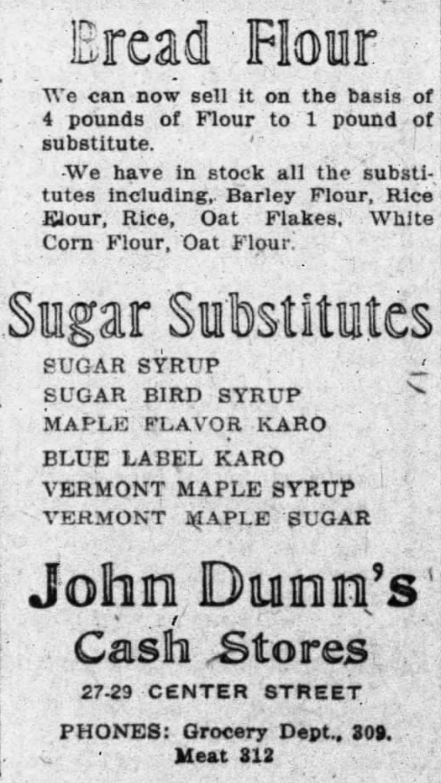 Newspaper advertisement for substitute flours and sugar substitutes for sale at John Dunn's cash stores.