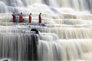 Monks meditation on waterfall