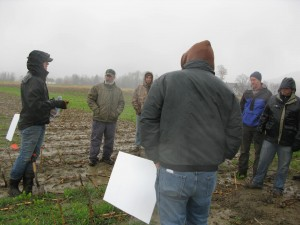 Meeting farmers where they are. On a cold & rainy November day, Kirsten leads a field day demonstrating cover crops in silage corn acreage.