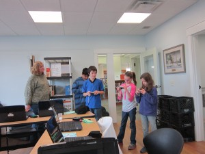 Tech Wizard participants at the Fairfield Library prepare for a photography scavenger hunt.